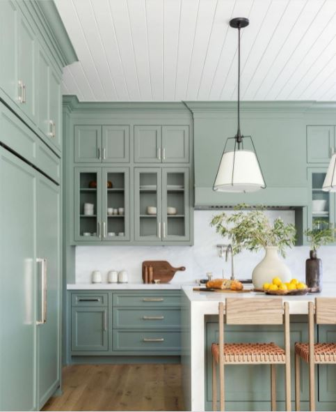 Green cabinets in a large kitchen