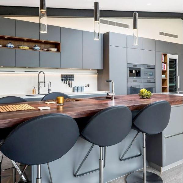 A modern kitchen with sleek cabinets and futuristic decor