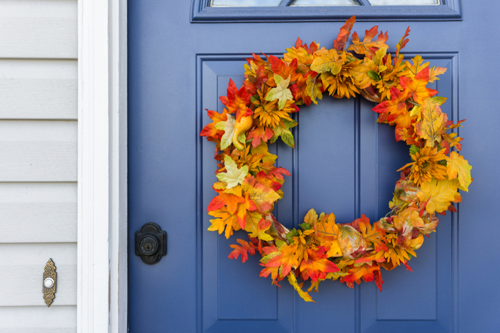 A fall wreath on a blue front door