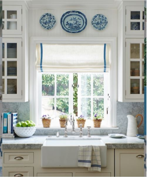 A casement window above the sink in a quaint and charming kitchen
