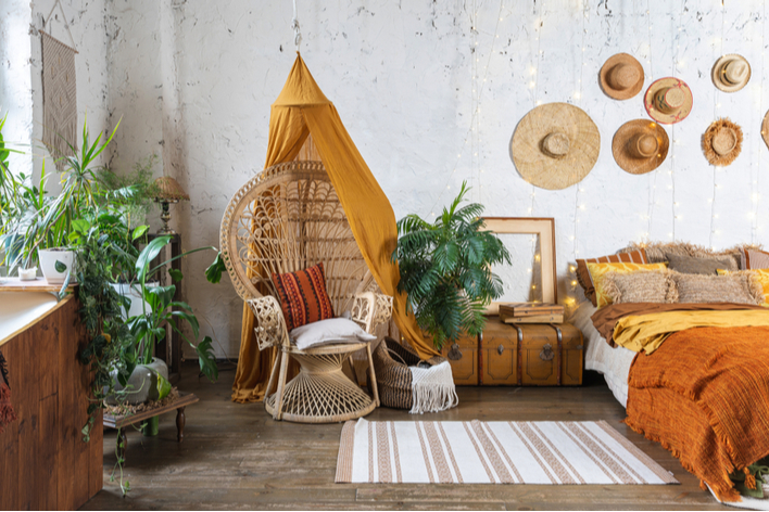 Gold and orange bohemian style bedroom with plants
