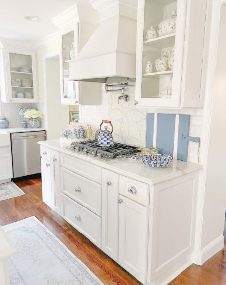 A beautiful classic white kitchen with blue kitchenware