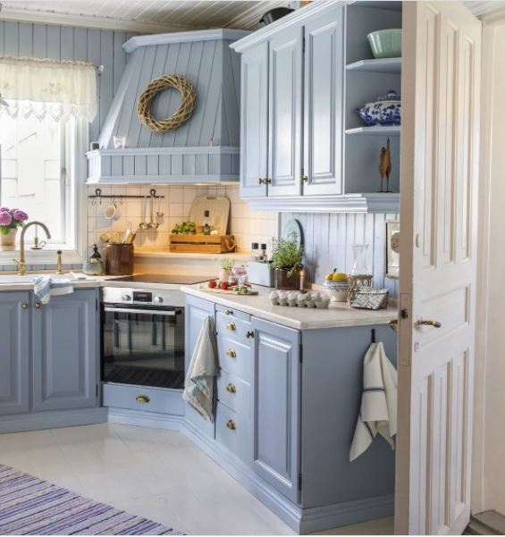 A cute kitchen with powder blue cabinets
