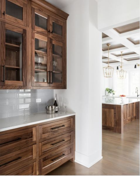 Wood stained cabinets in a beautiful white kitchen