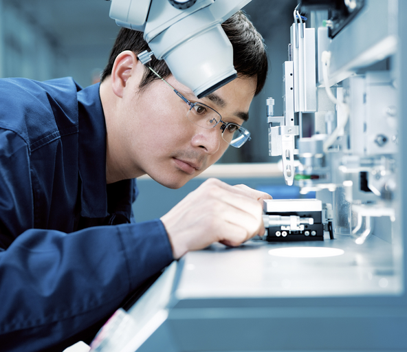 Man working in the electronics production