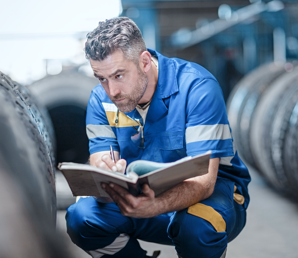 Man who makes notes in the tire store