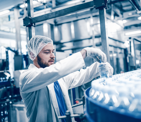 Man placing drinks in a beverage warehouse