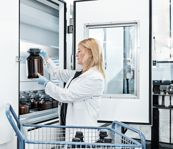 A woman works on a Vertical Lift Module with drying technology