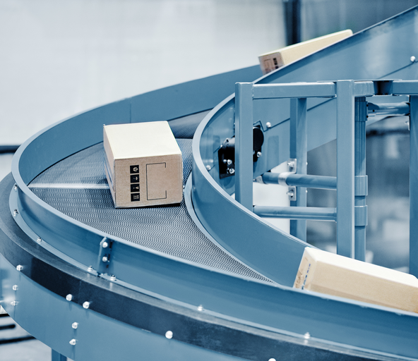 Cartons with customer orders on a conveyor