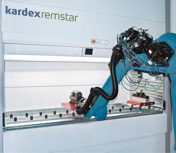 Robot picking and placing items in a Kardex Vertical Lift Module