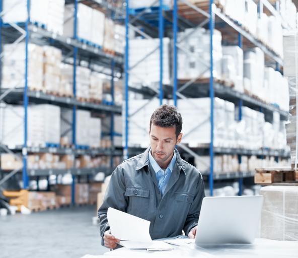 Men walk in a big warehouse