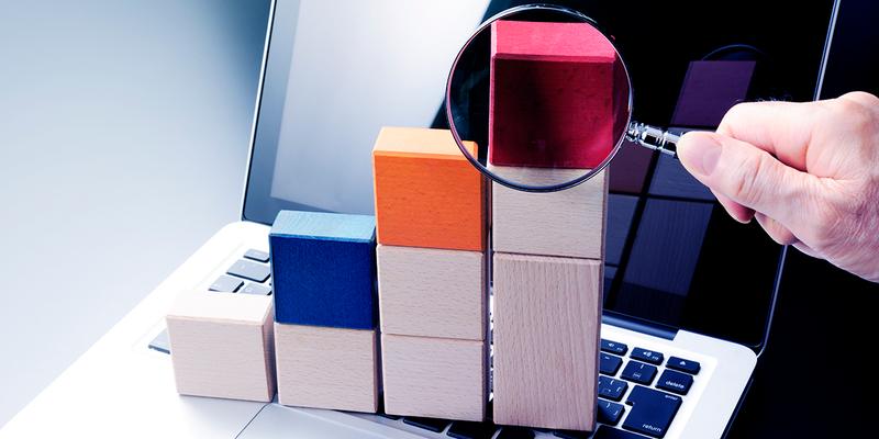Magnifying glass examining blocks