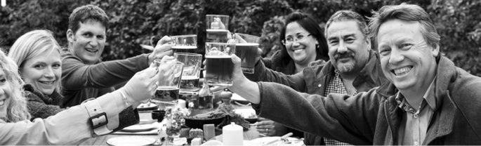 people clinking glasses of cider