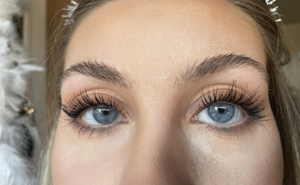 close up of girl with mascara on from front