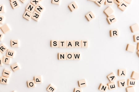 "scrabble tiles spelling out ""start now"""