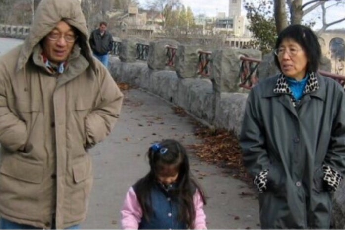 Image of Darya (contributor) at a young age between her uncle and her grandmother, walking with coats on