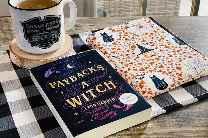 book on table with tea and book sleeve