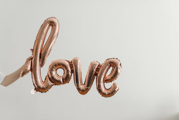 Helium balloons that spell 'love' in cursive