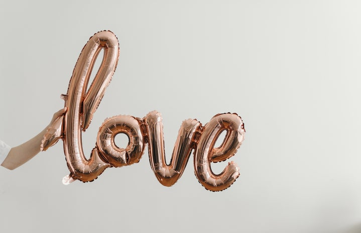Helium balloons that spell \'love\' in cursive