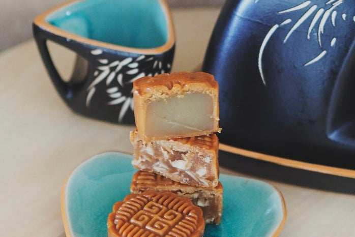 a plate of mooncakes and a teapot