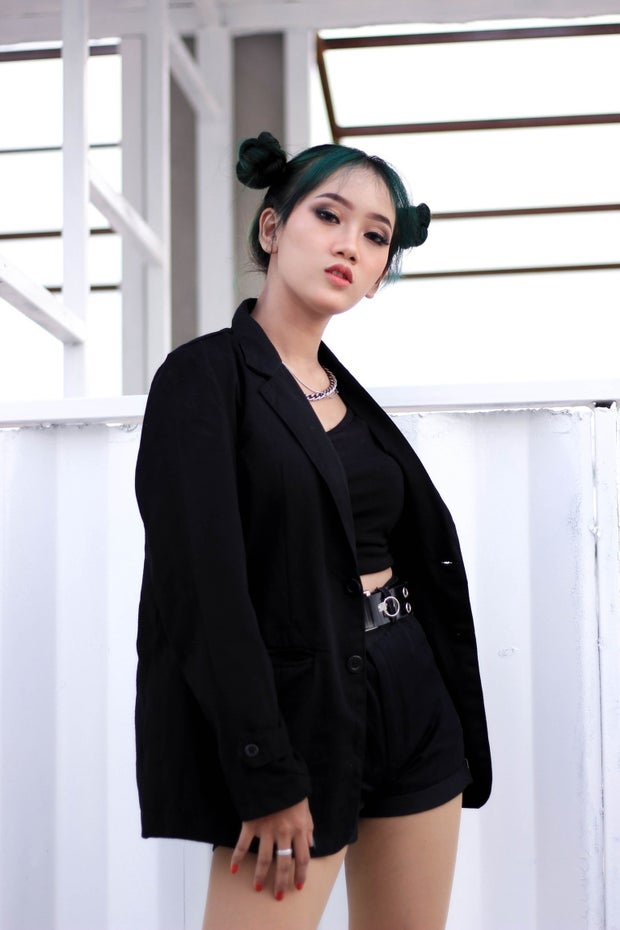 woman in all-black outfit looking at camera