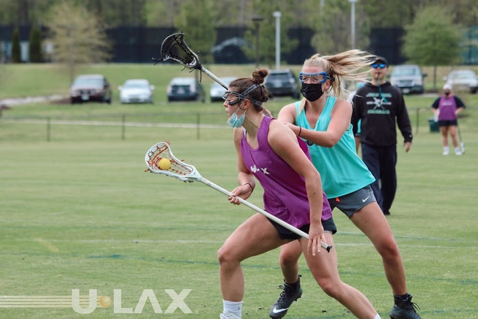 Woman playing lacrosse