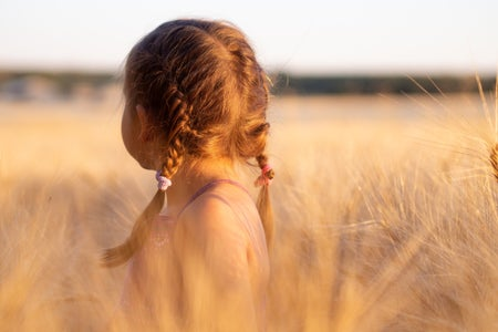 young girl staring into distance