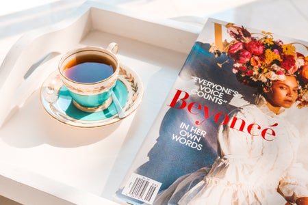 Beyonce magazine near tea on teacup