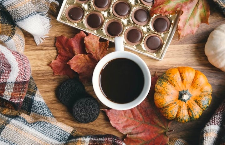 table with coffee, chocolate, blanket, leaves, oreos
