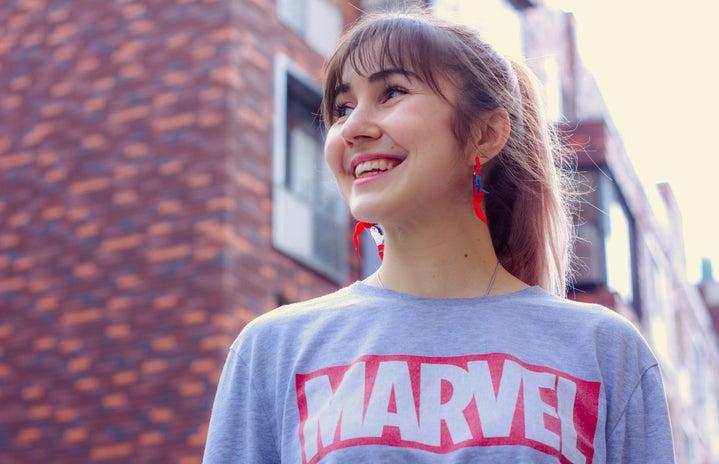 woman wearing a Marvel shirt