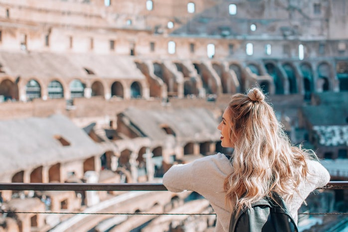 Woman visiting the Colosseum in Rome, Italy
