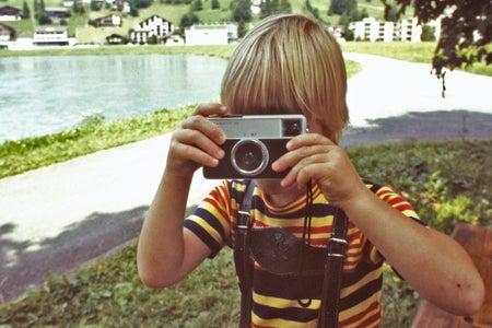 blonde boy with vintage camera