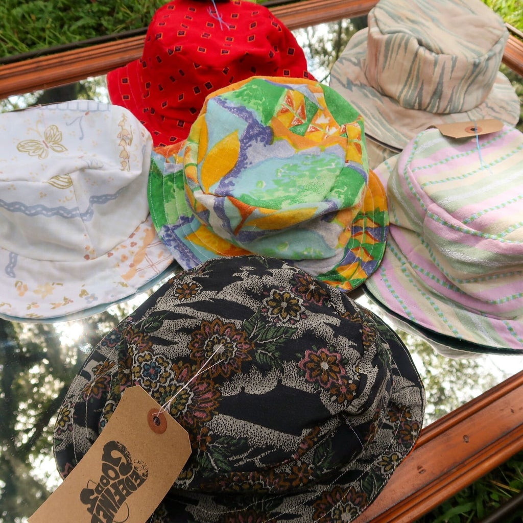 Selection of handmade bucket by Mia Crisosto using upcycled materials