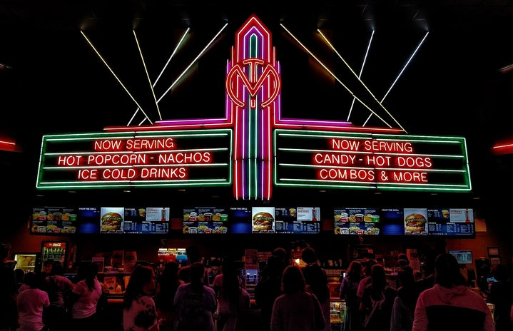 neon movie theatre sign