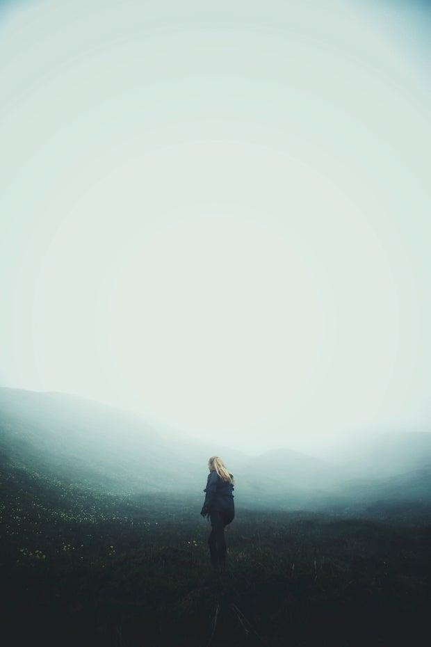 Women in a foggy landscape