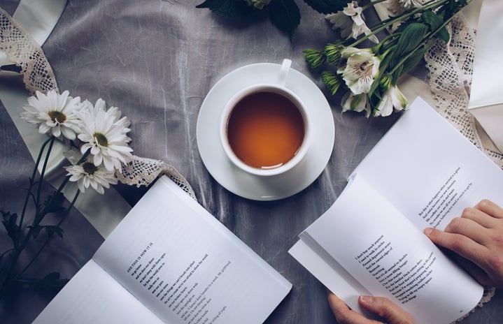 A cup of tea and poetry books