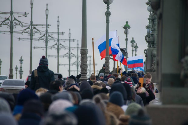 Group of people marching during Russian protests