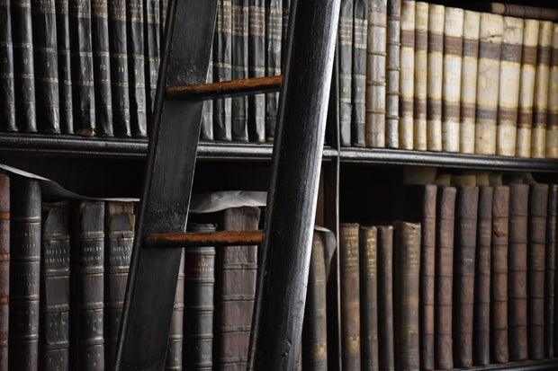 Library with old books and ladder