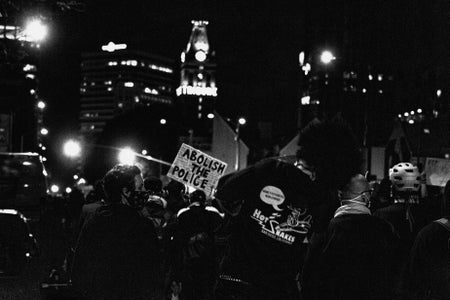 grey scale photo of a protest