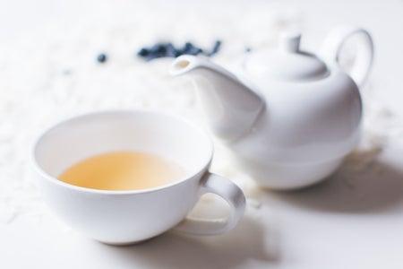 Tea pot with cup of tea