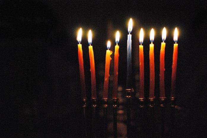 9 candles lit on menorah for hanukkah