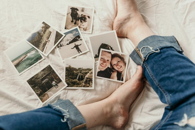 printed photos laying on bed