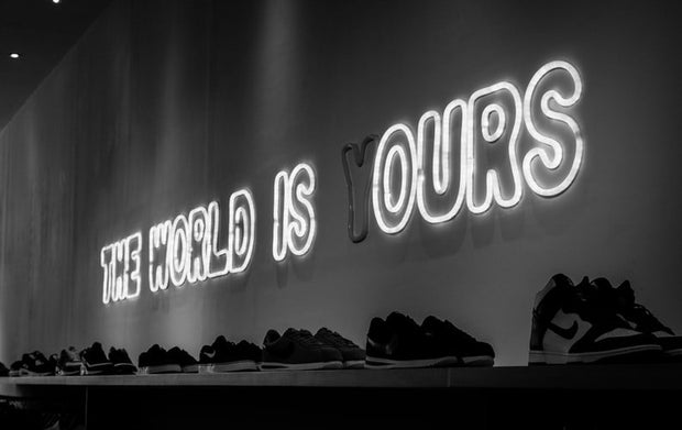 the world is ours neon sign
