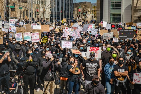 crowd of protesters against Asian hate