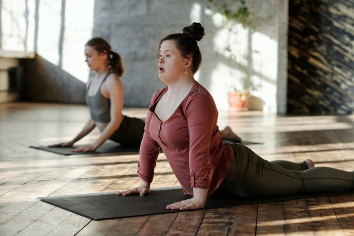 young person practiving yoga in studio