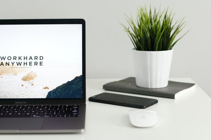 "macbook photo with screensave \""work hard anywhere\"""