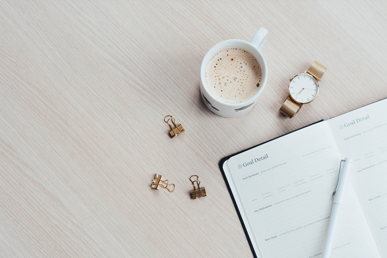 Coffee next to planner