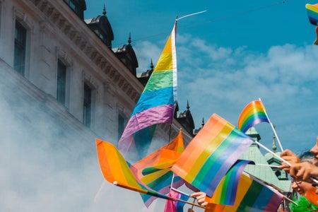Gay pride flags waving in the air