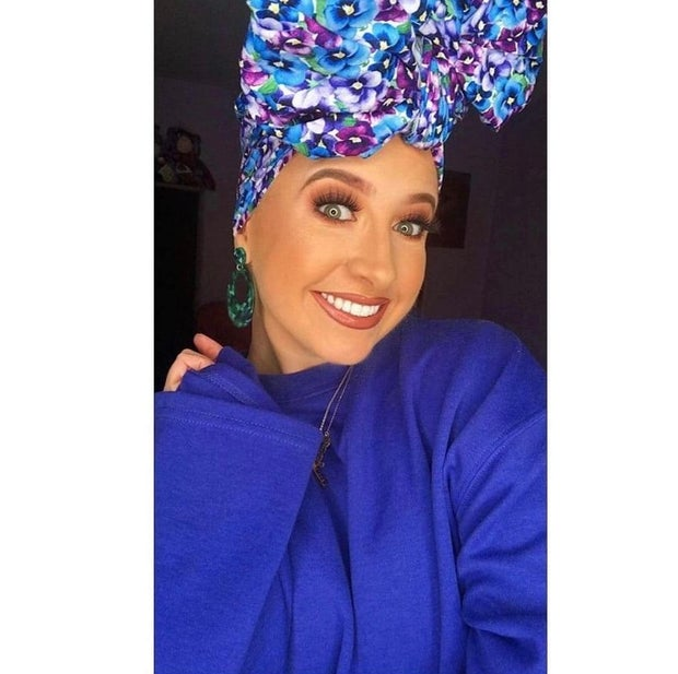 Carly Mahady a young Irish cancer survivor wearing a head dress to show fashion of cancer patients