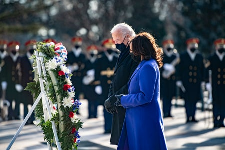 Joe Biden and Kamala Harris lay a wreath at the Tomb of the Unknown Soldier at Arlington National Cemetery